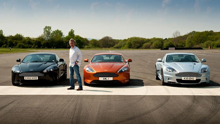 "James May prepares to drag race the new Aston Martin Virage against the Aston Martin DBS and DBS and DB9 as seen in ""Top Gear."""