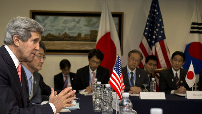 U.S. Secretary of State John Kerry, left, speaks during a meeting with Japan and South Korea during the ASEAN meetings in Bandar Seri Begawan, Brunei on Monday, July 1, 2013. (AP Photo/Jacquelyn Martin, Pool)