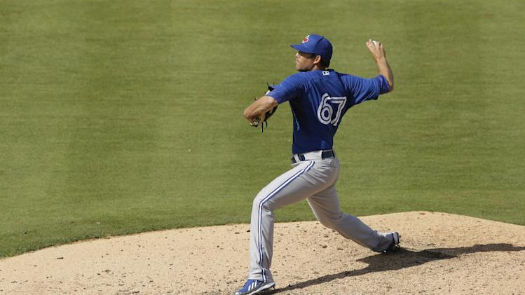 Toronto Blue Jays pitcher Ryan Tepera throws during the 10th inning of a spring exhibition baseball game against the Detroit Tigers in Lakeland, Fla., Tuesday, March 11, 2014. (AP Photo/Carlos Osorio)