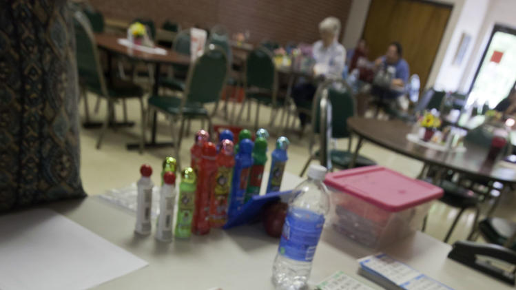 In this photo taken Tuesday, April 10, 2012, Bingo cards are purchased in Bald Knob, Ark. (AP Photo/Danny Johnston)