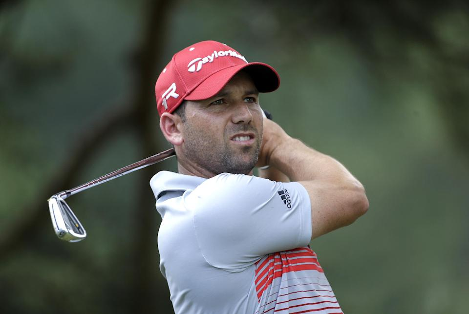Sergio Garcia, of Spain, tees off on the eighth hole during the first round of the U.S. Open golf tournament at Merion Golf Club, Thursday, June 13, 2013, in Ardmore, Pa. (AP Photo/Julio Cortez)