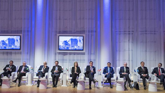 Pakistan's Prime Minister Mohammad Nawaz Sharif, left, Brazil's Vice President Michel Temer, second left, Indian Foreign Minister Salman Khurshid, third from left, British Prime Minister David Cameron, fifth from right, Indonesia's Vice President Boediono, fourth from right, European Council President Herman Van Rompuy, third from right, and U.N. Secretary General Ban Ki-moon, second right, attend an informal plenary session on the last day of the Nuclear Security Summit (NSS) in The Hague, Netherlands, Tuesday, March 25, 2014. (AP Photo/Bart Maat, POOL)