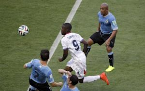 Costa Rica's Joel Campbell is flanked by Uruguay's …