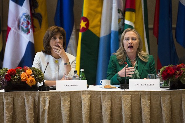 United States Secretary of State Hillary Clinton, right, alongside Columbian Foreign Minister María Ángela Holguín Cuéllarmeets addresses the Connecting the Americas meeting the Waldorf Astoria hotel, Thursday, Sept. 27, 2012 in New York. (AP Photo/John Minchillo)