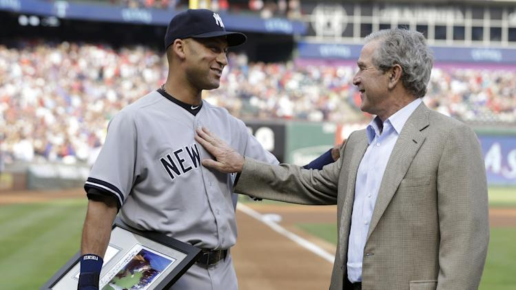 New York Yankees Derek Jeter, left, and former President George W. Bush greet each other during a ceremony honoring Jeter before a baseball game against the Texas Rangers Wednesday, July 30, 2014, in Arlington, Texas. (AP Photo/LM Otero)