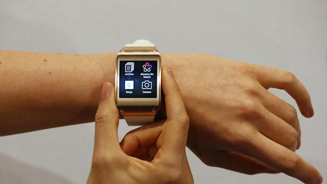 Model presents Samsung Galaxy Gear smartwatch after its launch at the IFA consumer electronics fair in Berlin