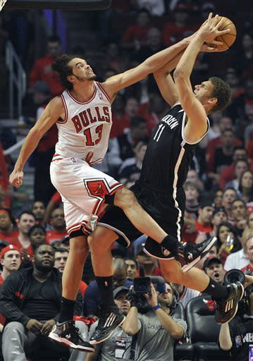 Robinson surge leads Bulls past Nets in triple OT