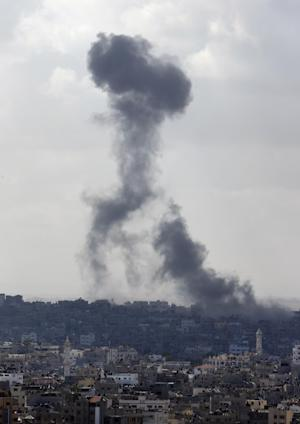 Smoke from an Israeli strike rises over the Gaza Strip, Friday, July 25, 2014. An Israeli defense official says the Israeli Security Cabinet is meeting to discuss international ceasefire efforts, but also the option of expanding its eight-day-old ground operation in Gaza. (AP Photo/Lefteris Pitarakis)