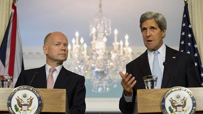 Secretary of State John Kerry gestures as he speaks during a joint news conference with British Foreign Secretary William Hague at the State Department in Washington, Wednesday, June 12, 2013. Kerry hosted a meeting with Hague, an ally equally unsure about what to do to end fighting in Syria that has now killed some 80,000 people. (AP Photo/Jacquelyn Martin)