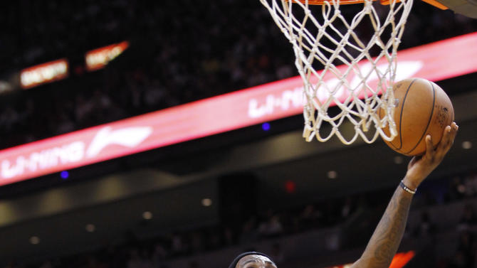 Miami Heat forward LeBron James (6) goes up for a shot against Brooklyn Nets forward Gerald Wallace (45) during the first half of an NBA basketball game, Saturday, Dec. 1, 2012 in Miami. (AP Photo/Wilfredo Lee)