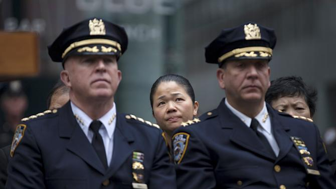 A family member of slain NYPD officer Liu attends an event held by the National Law Enforcement Officers Fund at Times Square in New York