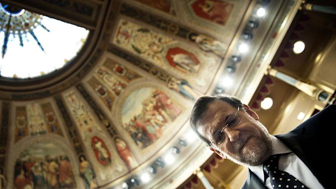 Spain's Prime Minister Mariano Rajoy looks down as he arrives for a debate on the 2013 budget spending cuts at the Spanish Parliament in Madrid, Tuesday Oct. 23, 2012. The government has introduced austerity measures and financial and labor reforms in a bid to convince investors it is getting a grip on its accounts. The measures have led to many strikes and protests and the country faces its second general strike in a year on Nov. 14 while Spain is battling recession.(AP Photo/Daniel Ochoa de Olza)