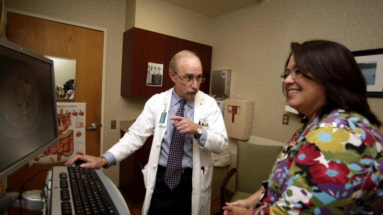 Dr. Paul J. Pockros, head, Division of Gastroenterology/ Hepatology and director, Liver Disease Center, talks with patient Loretta Roberts as they view her information on a computer screen in his exam room at Scripps Green Hospital in San Diego, in this photo taken Thursday, Jan. 13, 2011. (AP Photo/Lenny Ignelzi)