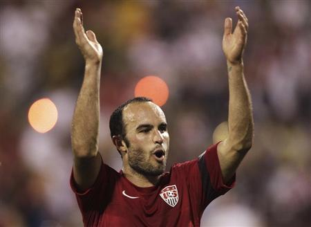 United States' Donovan celebrates their victory over Mexico in their FIFA World Cup qualifying soccer match in Columbus