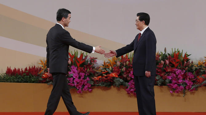 Chinese President Hu Jintao, right, shakes hands with Hong Kong's new Chief Executive Leung Chun-ying after Leung was sworn in, at the Hong Kong Convention and Exhibition Center in Hong Kong Sunday, July 1, 2012. Hong Kong's new Beijing-backed leader was sworn in on Sunday amid a rising tide of public discontent over widening inequality and lack of full democracy in the semiautonomous southern Chinese financial center. (AP Photo/Vincent Yu)