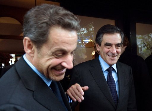 <p>Former French president Nicolas Sarkozy (L) and ex-prime minister Francois Fillon leave a restaurant in October 2012. Sarkozy on Monday waded in to a bitter leadership battle that has left France's main right-wing opposition party, the UMP, on the verge of collapse.</p>