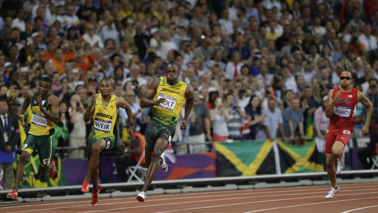 Jamaica's Usain Bolt, center, runs to win gold in the men's 200-meter final during the athletics in the Olympic Stadium at the 2012 Summer Olympics, London, Thursday, Aug. 9, 2012. Others runners are, from left, South Africa's Anaso Jobodwana, Jamaica's Warren Weir and United States' Wallace Spearmon. (AP Photo/Matt Slocum)