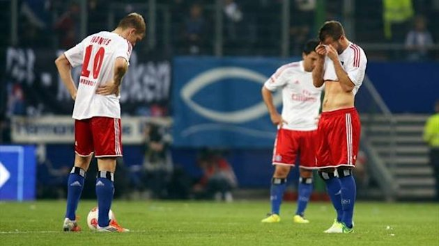 Rafael van der Vaart reacts after Hamburg lose to Stuttgart
