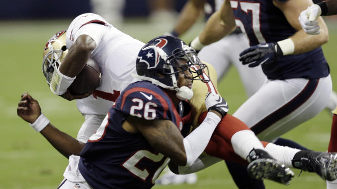 Houston Texans' Brandon Harris (26) upends San Francisco 49ers quarterback  Josh Johnson (1) in the fourth quarter an NFL preseason football game Saturday, Aug. 18, 2012, in Houston. (AP Photo/David J. Phillip)