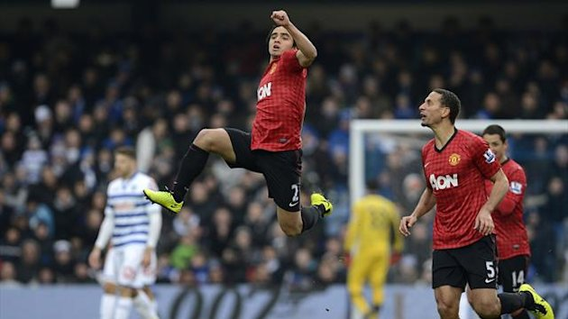 Manchester United's Rafael da Silva (C) celebrates scoring against Queens Park Rangers during their English Premier League soccer match in London February 23, 2013 (Reuters)