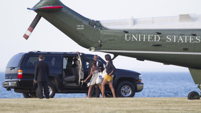 Sasha Obama, left, and Malia Obama, right, walk from Marine One to the motorcade as they arrive at the 37th Street Lake Front landing zone,  Friday, June 15, 2012, in Chicago. (AP Photo/Carolyn Kaster)