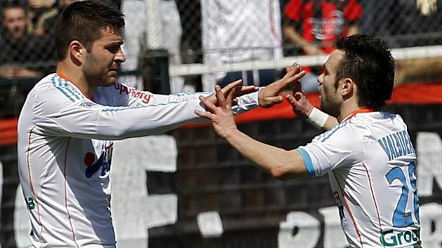 Marseille's Andre-Pierre Gignac (L) celebrates with teammate Mathieu Valbuena after scoring against OGC Nice during their Ligue 1 soccer match at the Le Ray stadium in Nice (Reuters)