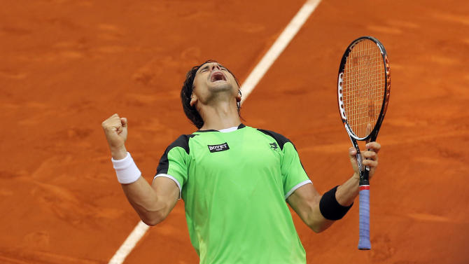 David Ferrer from Spain celebrates his victory during the match against Tommy Haas from Germany at the Madrid Open tennis tournament, in Madrid, Thursday, May 9, 2013. (AP Photo/Andres Kudacki)