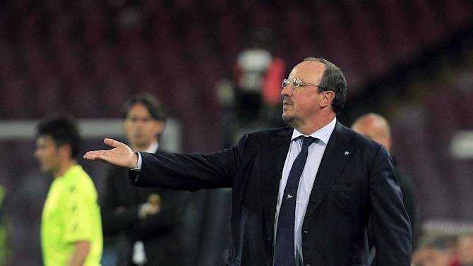 Napoli's coach Benitez reacts during their Italian Serie A soccer match against AC Milan at the San Paolo stadium in Naples