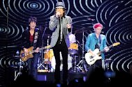 Ronnie Wood, Mick Jagger and Keith Richards of the Rolling Stones perform at 02 Arena on November 25, 2012 in London, England.