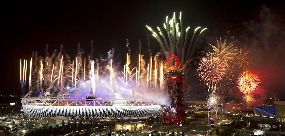 Fireworks explode over the Olympic Stadium at the closing ceremony of the 2012 Summer Olympics, Monday, Aug. 13, 2012, in London. (AP Photo/Ben Curtis)