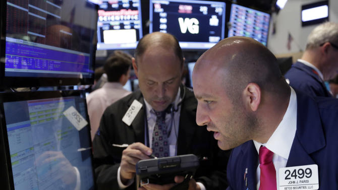In this Thursday, June 20, 2013, photo, specialist John Parisi, right, works with traders on the floor of the New York Stock Exchange.Asian stocks endured moderate losses Friday June 21, 2013 but European markets appeared set to stabilize even though investors remained edgy about a possible change of course by the U.S. Federal Reserve. (AP Photo/Richard Drew)