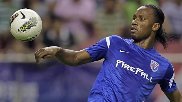 Shanghai Shenhua's striker Didier Drogba controls the ball during the Chinese Super League match against Hangzhou Green Town (Reuters)