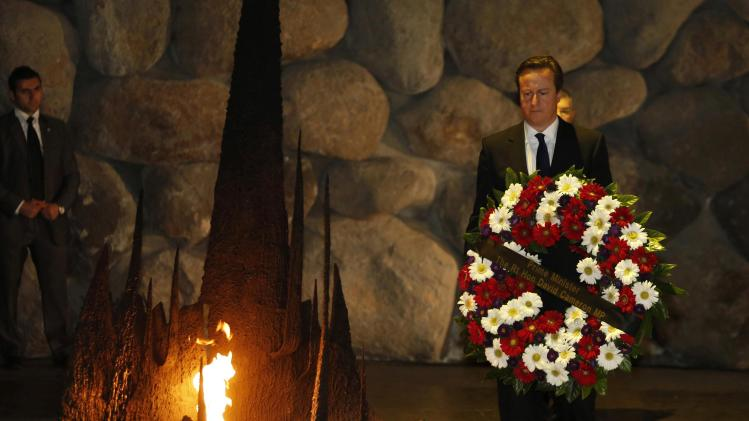 British Prime Minister Cameron lays a wreath during a ceremony at the Yad Vashem Holocaust memorial in Jerusalem