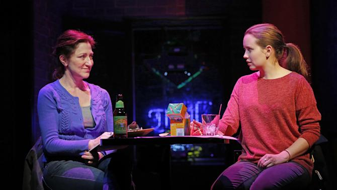 """This undated theater image released by Boneau/Bryan-Brown shows Edie Falco, left, and Phoebe Strole during a performance of """"The Madrid."""" (AP Photo/Boneau/Bryan-Brown, Joan Marcus)"""