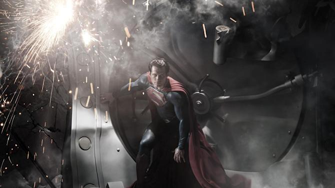 """FILE - This file film image released by Warner Bros. Pictures shows Henry Cavill as Superman in """"Man of Steel."""" The film's director Zack Snyder says there was never any discussion about altering a pivotal scene involving a twister following recent storms in Oklahoma. (AP Photo/Warner Bros. Pictures, Clay Enos, File)"""