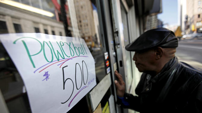 A sign posted to a doorway of a convenience store advertises the current Powerball jackpot at $500 million, Wednesday, Nov. 28, 2012, in Atlanta. (AP Photo/David Goldman)