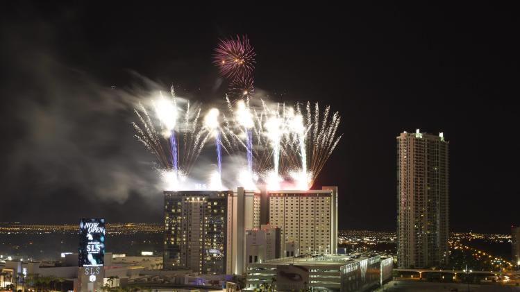 Fireworks explode during the grand opening of the SLS Las Vegas just after midnight in Las Vegas