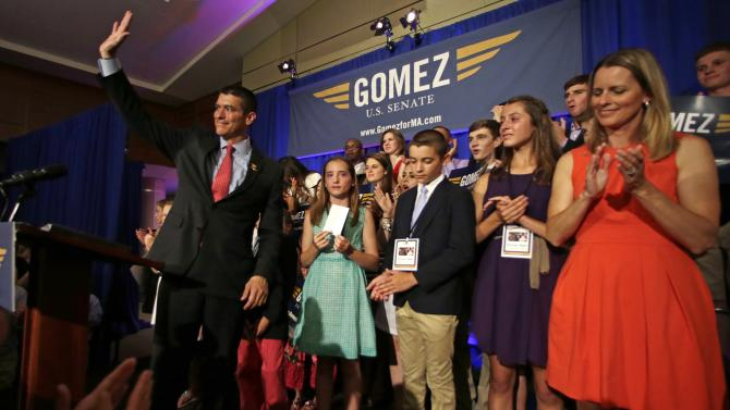Gabriel Gomez, the Republican candidate for U.S. Senate in the Massachusetts open seat special election, waves to supporters while standing with his wife Sarah, right, and children during an election day party in Boston, Tuesday, June 25, 2013. Gomez lost his bid against Democrat U.S. Rep. Ed Markey, who won the election and will take the seat vacated by John Kerry's departure to become Secretary of State. (AP Photo/Charles Krupa)