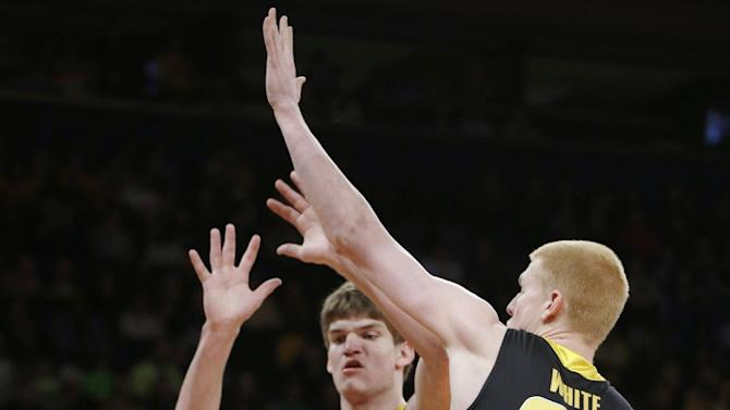 Baylor's Cory Jefferson (34) looks for a shot as Iowa's Aaron White (30) and Adam Woodbury defend during the first half of the NIT championship basketball game Thursday, April 4, 2013, in New York. (AP Photo/Frank Franklin II)