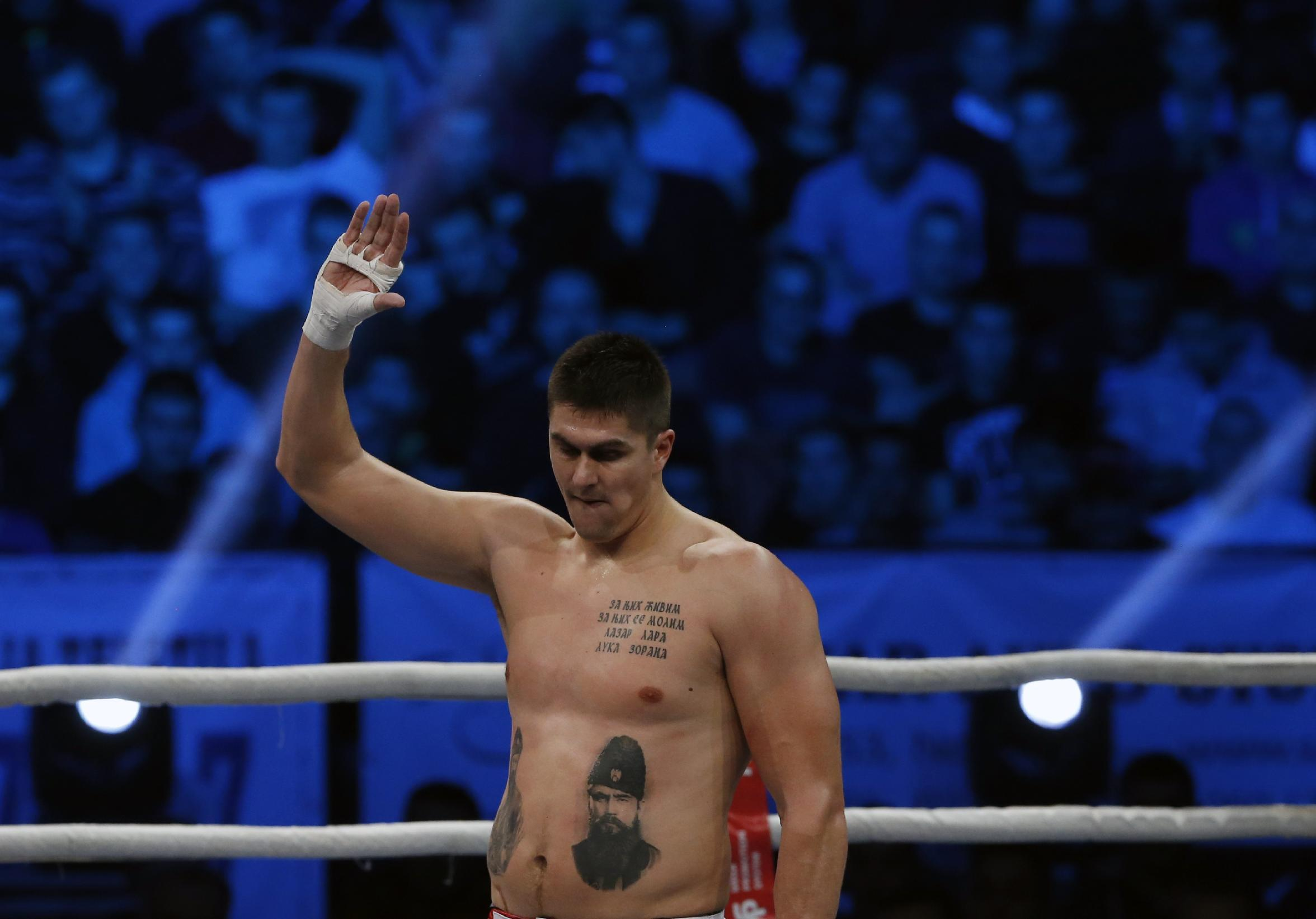 Here's a shirtless Darko Milicic singing and giving beer to his tattoos