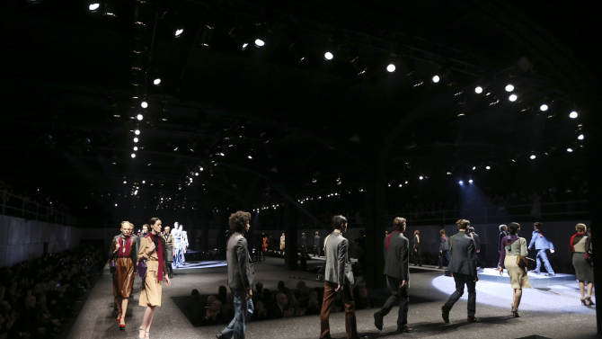 Models wear creations for Prada men's Fall-Winter 2014 collection, part of the Milan Fashion Week, unveiled in Milan, Italy, Sunday, Jan.12, 2014. (AP Photo/Luca Bruno)