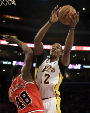 Los Angeles Lakers center Dwight Howard (12) shoots as Chicago Bulls center Nazr Mohammed (48) defends in the first half of an NBA basketball game in Los Angeles Sunday March 10, 2013. (AP Photo/Reed Saxon)