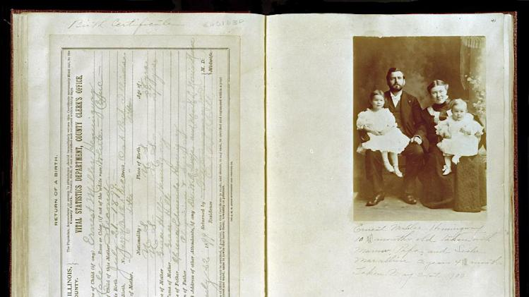 This photo provided July 17, 2013, by the John F. Kennedy Presidential Library shows the birth certificate and family photograph of Ernest Hemingway from a scrapbook created by his mother, Grace Hall Hemingway, at the John F. Kennedy Presidential Library in Boston. The JFK Library and Museum in Boston has digitized pages from five scrapbooks that the mother of Ernest Hemingway made to document his early life. (AP Photo/John F. Kennedy Presidential Library)