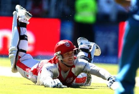 Pomersbach of the Kings XI Punjab is run out by Gibbs of Deccan Chargers during the 2009 Indian Premier League cricket match in Johannesburg