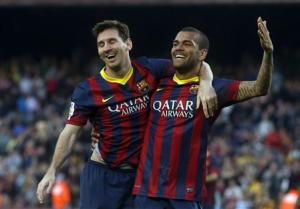 Barcelona's Lionel Messi and Dani Alves celebrate a goal against Osasuna during the Spanish first division soccer match at Camp Nou stadium in Barcelona