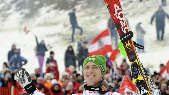 Austria's Marcel Hirscher celebrates after winning an alpine ski, men's World Cup slalom in Kitzbuehel, Austria, Sunday, Jan. 27, 2013. (AP Photo/Giovanni Auletta)