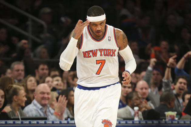 New York Knicks forward Carmelo Anthony jogs after scoring during the second half of an NBA basketball game against the Atlanta Hawks, Saturday, Dec. 14, 2013, in New York. The Knicks won 111-106