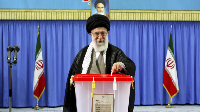 """FILE - In this Friday, June 14, 2013 file photo released by an official website of the Iranian supreme leader's office, Supreme Leader Ayatollah Ali Khamenei casts his ballot in the presidential election without publicly endorsing a candidate, in Tehran. Iran's supreme leader says a solution to the nuclear impasse with the West is """"easy"""" if the country's foes are serious about reaching a deal. (AP Photo/Office of the Supreme Leader, File)"""