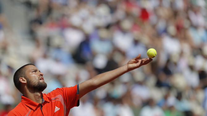 Russia's Mikhail Youzhny serves to Spain's David Ferrer during their third round match in the French Open tennis tournament at the Roland Garros stadium in Paris, Saturday, June 2, 2012.  (AP Photo/Bernat Armangue)