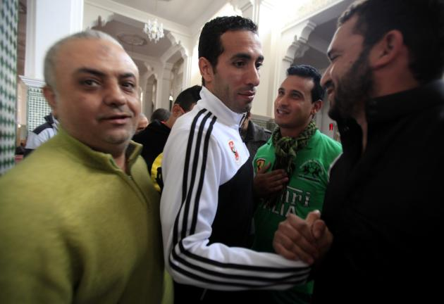Moroccans surrounded and cheer for Mohamed Aboutrika of Egypt's Al Ahly after Friday prayers at Lebanon Mosque in Agadir